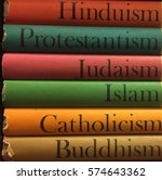 Stack of colorful books of different religions: Islam, Catholicism, Buddhism, Judaism, Protestantism, Hinduism