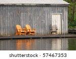 Three woden chairs - stock photo