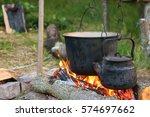 tourist pot over camp fire | Shutterstock . vector #574697662