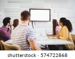 young executives watching at... | Shutterstock . vector #574722868