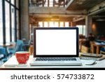 front view of cup and laptop on ... | Shutterstock . vector #574733872