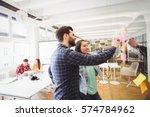 smiling business people looking ... | Shutterstock . vector #574784962