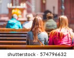 people praying in a church | Shutterstock . vector #574796632