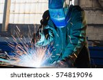 Welders Working At The Factory...