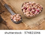 pinto beans on wood bowl | Shutterstock . vector #574821046