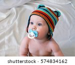 baby boy with pacifier. baby... | Shutterstock . vector #574834162