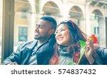 happy interracial couple of...   Shutterstock . vector #574837432