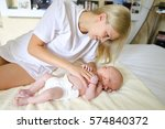 young mother holds baby head... | Shutterstock . vector #574840372