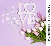 hearts and tulips on purple... | Shutterstock . vector #574848352