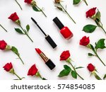 Stock photo colorful composition with red bright roses cosmetics woman accessories flat lay on white table 574854085