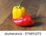 yellow and red pepper on wooden ... | Shutterstock . vector #574891072