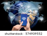Small photo of Hand holding smart phone on world map network and wireless communication network, abstract image visual, internet of things.Elements of this image furnished by NASA