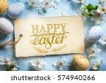 spring flowers and easter eggs. ... | Shutterstock . vector #574940266