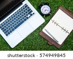 laptop  notebook  and the clock ... | Shutterstock . vector #574949845
