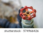 the red old rusty valve of the... | Shutterstock . vector #574966426