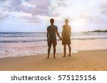 young couple is standing at... | Shutterstock . vector #575125156