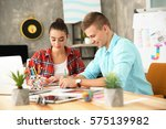 two young designers at workplace   Shutterstock . vector #575139982