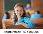 young female student at lecture ... | Shutterstock . vector #575189008