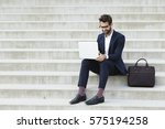 businessman on laptop with... | Shutterstock . vector #575194258
