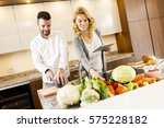 young couple cooking in the... | Shutterstock . vector #575228182