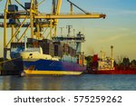 unloading a container ship in... | Shutterstock . vector #575259262