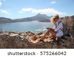 girl on the top of gramvousa... | Shutterstock . vector #575266042