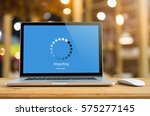 laptop on table with importing...   Shutterstock . vector #575277145