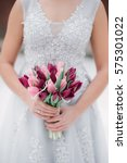 a bouquet of tulips in her hands | Shutterstock . vector #575301022