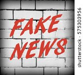 the words fake news in red text ...   Shutterstock . vector #575303956