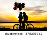 silhouette of two people on... | Shutterstock . vector #575309362