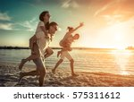 friends fun on the beach under... | Shutterstock . vector #575311612