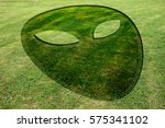 alien face fake crop circle in... | Shutterstock . vector #575341102