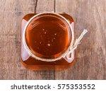 honey jar on wood. | Shutterstock . vector #575353552