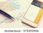 data analyzing with calculator... | Shutterstock . vector #575353906