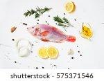 fresh tilapia on white wooden...   Shutterstock . vector #575371546