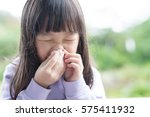 little girl get cold and blow... | Shutterstock . vector #575411932
