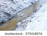 A Frozen Wood Ladder Bridge Fo...