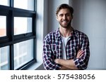 portrait of smiling young man... | Shutterstock . vector #575438056