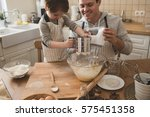 a father and his son cooking   Shutterstock . vector #575451358