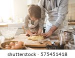 a father and his son cooking | Shutterstock . vector #575451418