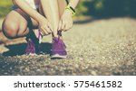 young woman in fitness wear... | Shutterstock . vector #575461582