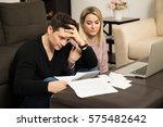 young couple looking stressed...   Shutterstock . vector #575482642