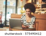 mixed race woman in coffee shop ... | Shutterstock . vector #575490412