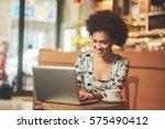 mixed race woman in coffee shop ... | Shutterstock . vector #575490412
