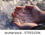hands holding ice crystals