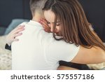 man and woman on the bed. close ... | Shutterstock . vector #575557186