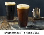 frothy nitro cold brew coffee... | Shutterstock . vector #575563168