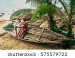 couple on the shore of paradise ... | Shutterstock . vector #575579722