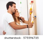 young couple decorate their new ... | Shutterstock . vector #575596735