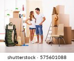 happy couple moving in new... | Shutterstock . vector #575601088